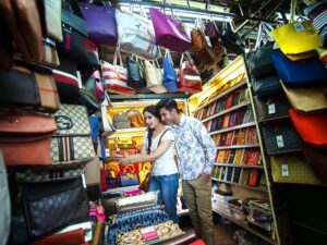 buying fake handbags in the chinatown kuala lumpur during the night city tour