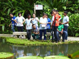 student visits to the pond area of the penang spice garden