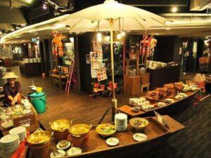 the baiyoke hotel floating market dining lets you sample dishes from bangkok's famous floating market