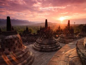 the amazing sunset over the horizon that you can see during the borobudur sunset tour in yogjakarta indonesia
