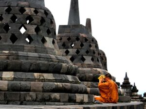 a monk at the borobudur temple complex indonesia