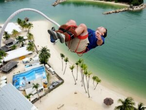 strapped to your legs, the sentosa island bungee jump is supervised by the top professional in the area - the aj hackett company