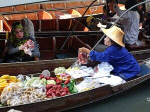 fruits to crafts are sold from a boat in the floating market of thailand