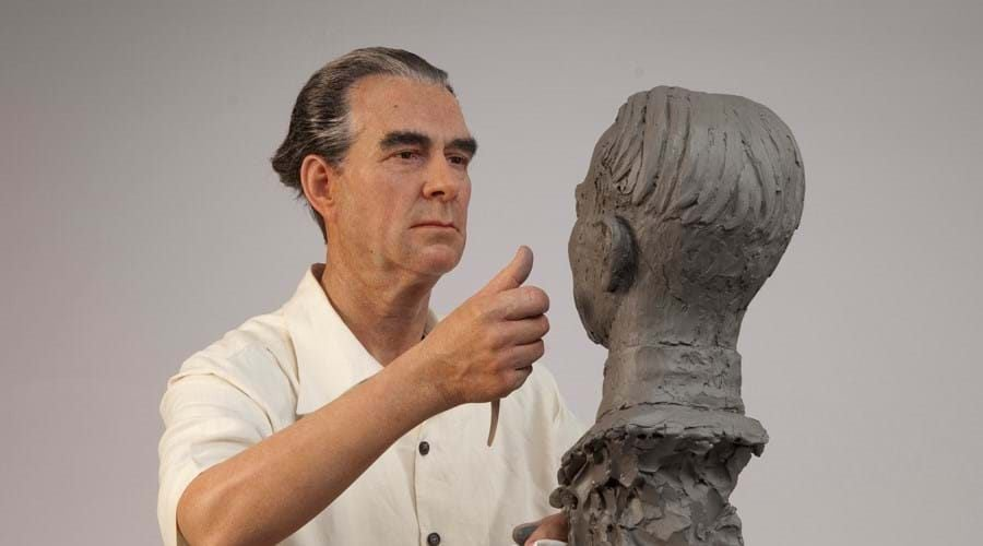 an expert sculpture working on his wax figure creation at the bangkok madame tussauds