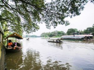 boats carrying passengers during the mae ping cruise at chiang mai