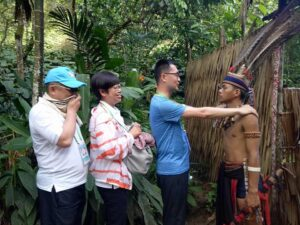 on your mari-mari cultural village tour, you'll experience the native greetings of the Sabah's aborigines like this
