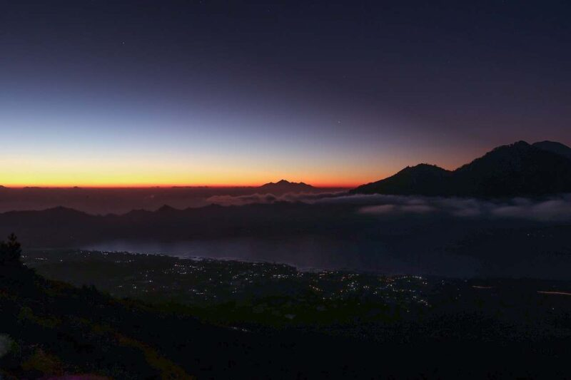 the view of mount batur in bali during a sunset tour