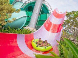 3 kids on a water slide at the ramayana pattaya water park