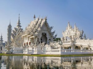 in the white temple and black temple tour you'll see the stunning eerie whit temple of chiang rai
