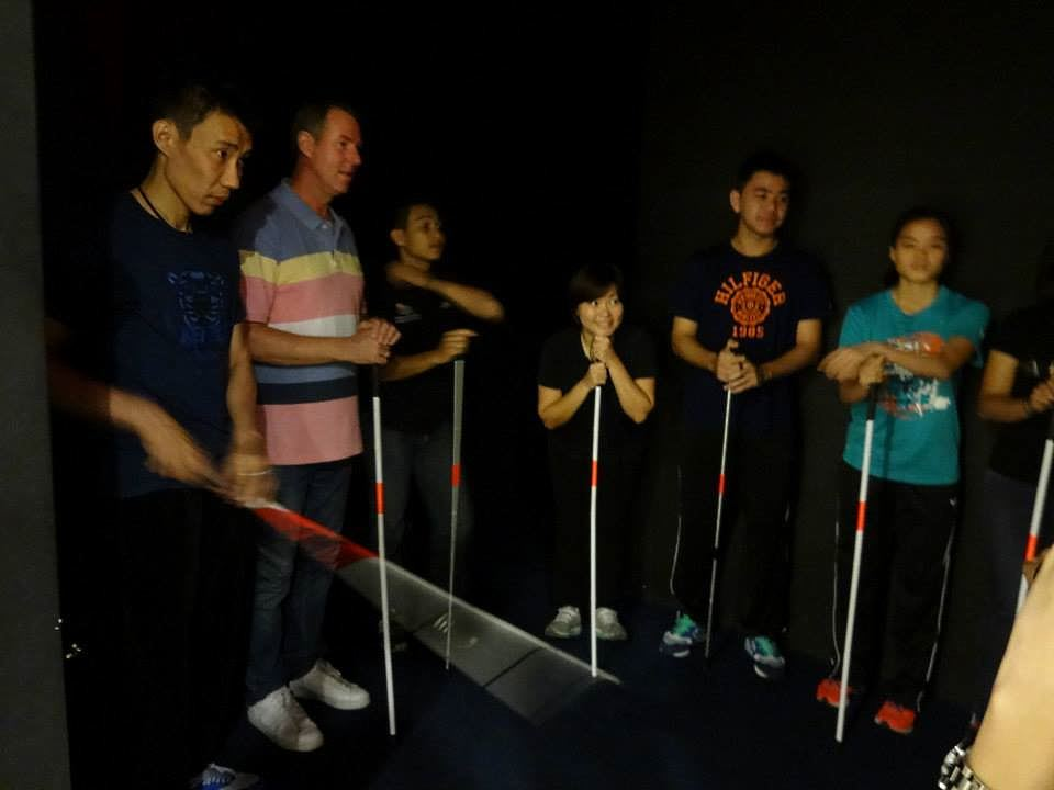 malaysian badminton players during their dialogue in the dark exhibition